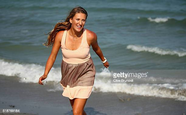 Victoria Azarenka of Belarus poses for a photograph on Crandon Park beach after her straight sets victory against Svetlana Kuznetsova of Russia in...