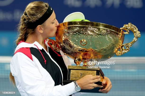 Victoria Azarenka of Belarus poses for photographers with the winner's trophy after defeating Maria Sharapova of Russia during the final of the China...
