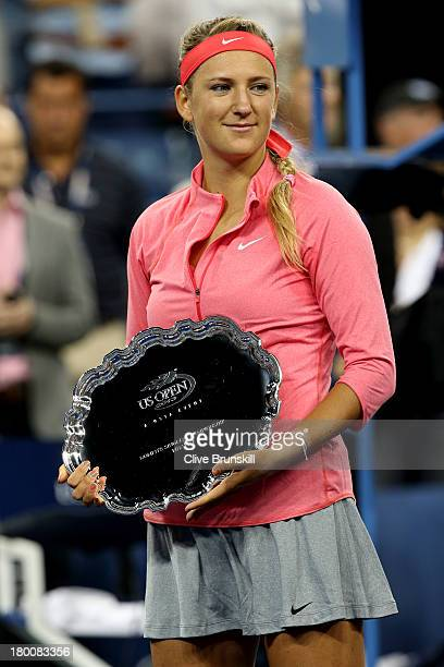 Victoria Azarenka of Belarus poses with her runner-up trophy after losing the women's singles final match against Serena Williams of the United...