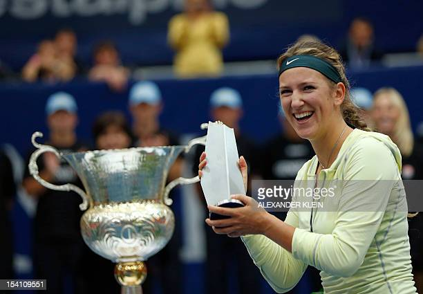 Victoria Azarenka of Belarus poses with her trophy after winning against Julia Goerges of Germany during the final of the Linz WTA tennis tournament...