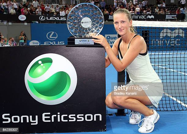Victoria Azarenka of Belarus poses with the Brisbane International winners trophy after defeating Marian Bartoli of France in the Womens final during...