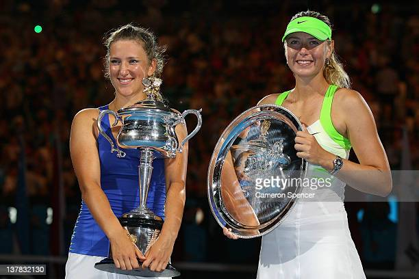 Victoria Azarenka of Belarus poses with the Daphne Akhurst Memorial Cup alongside Maria Sharapova of Russia with the runnersup trophy after winning...