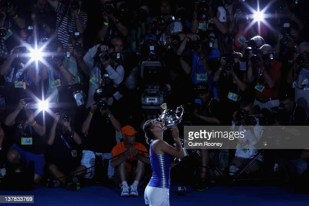 Victoria Azarenka of Belarus poses with the Daphne Akhurst Memorial Cup after winning her women's final match against Maria Sharapova of Russia and...