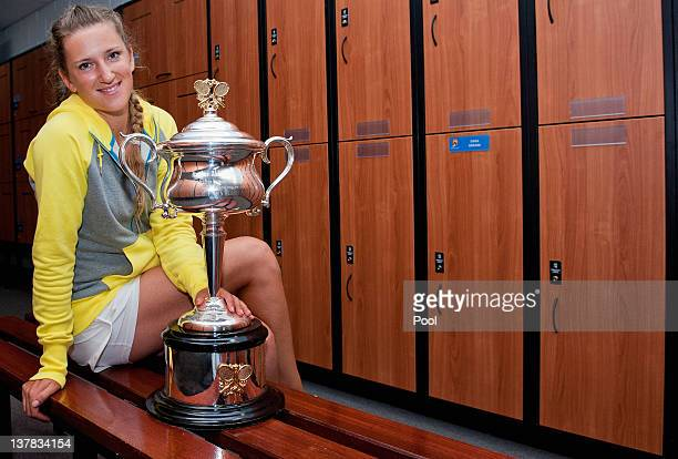 Victoria Azarenka of Belarus poses with the Daphne Akhurst Memorial Cup in the locker room after winning her women's final match against Maria...