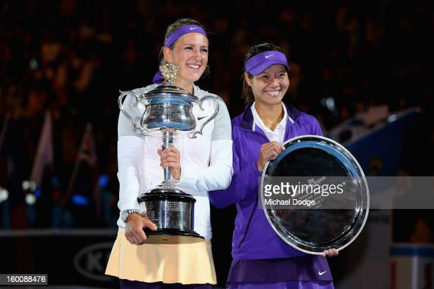 Victoria Azarenka of Belarus poses with the Daphne Akhurst Memorial Cup and Na Li of China with the runners up trophy after their women's final match...