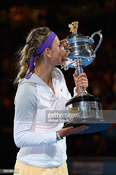 Victoria Azarenka of Belarus poses with the Daphne Akhurst Memorial Cup after winning her women's final match against Na Li of Chinaduring day...