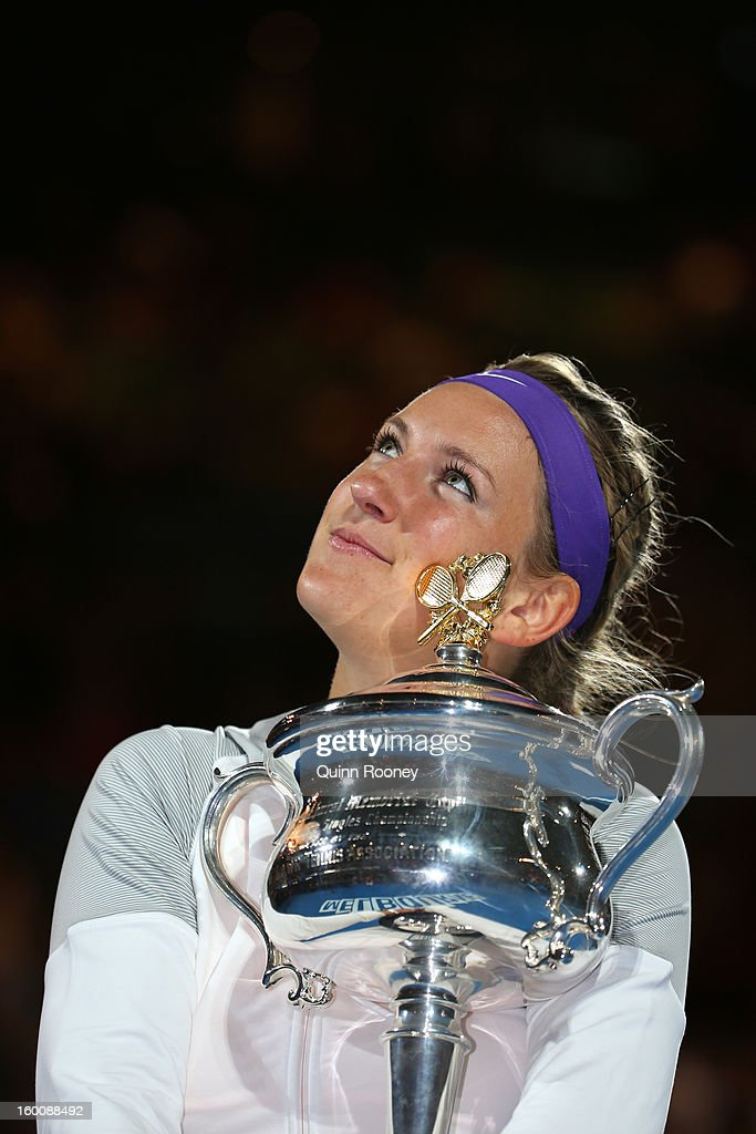 Victoria Azarenka of Belarus poses with the Daphne Akhurst Memorial Cup after winning her women's final match against Na Li of Chinaduring day thirteen of the 2013 Australian Open at Melbourne Park on January 26, 2013 in Melbourne, Australia.