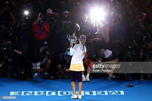 Victoria Azarenka of Belarus poses with the Daphne Akhurst Memorial Cup after winning her women's final match against Na Li of China during day...
