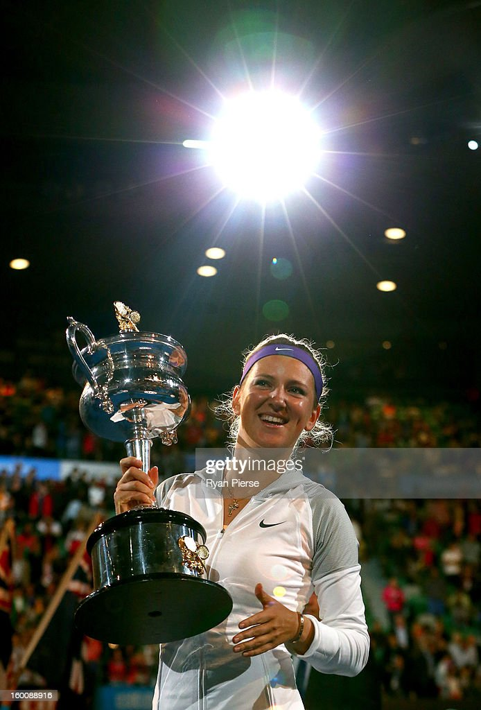 Victoria Azarenka of Belarus poses with the Daphne Akhurst Memorial Cup after winning her women's final match against Na Li of China during day thirteen of the 2013 Australian Open at Melbourne Park on January 26, 2013 in Melbourne, Australia.