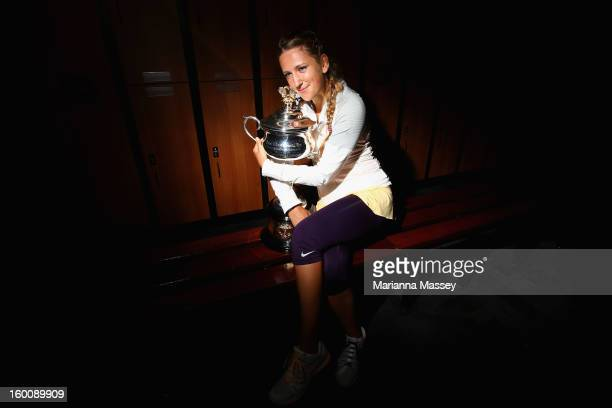 Victoria Azarenka of Belarus poses with the Daphne Akhurst Memorial Cup in the changerooms after winning her women's final match against Na Li of...