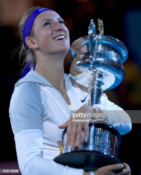 Victoria Azarenka of Belarus poses with the Daphne Akhurst Memorial Cup after winning her women's final match against Li Na of China during day...