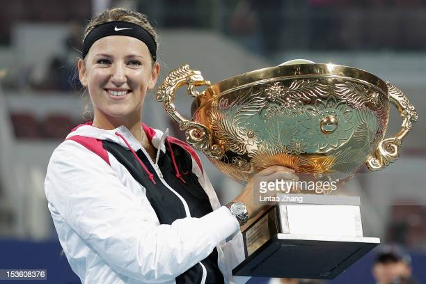 Victoria Azarenka of Belarus poses with the trophy after defeating Maria Sharapova of Russia in the Women's Single Final of the China Open at the...