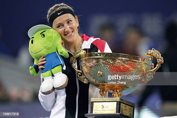 Victoria Azarenka of Belarus poses with the trophy after defeating Maria Sharapova of Russia during the Women's Singles Final of the China Open at...