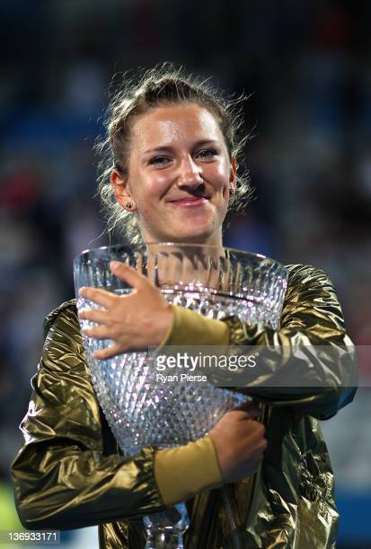 Victoria Azarenka of Belarus poses with the winners trophy after winning the Womens Final against Na Li of China during day six of the 2012 Sydney...