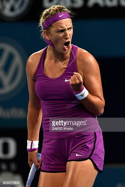 Victoria Azarenka of Belarus reacts after a point against Elena Vesnina of Russia in their women's singles match on the second day at the Brisbane...