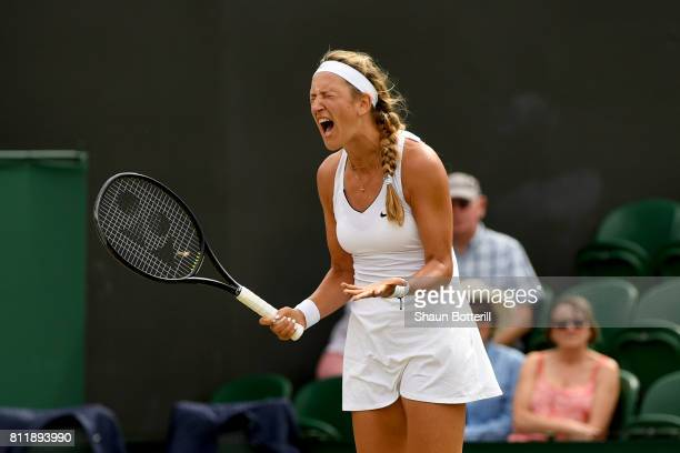 Victoria Azarenka of Belarus reacts during the Ladies Singles fourth round match against Simona Halep of Romania on day seven of the Wimbledon Lawn...