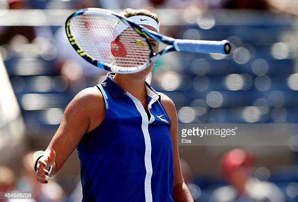 Victoria Azarenka of Belarus reacts to a point by throwing her racket in the second set against Ekaterina Makarova of Russia during their women's...