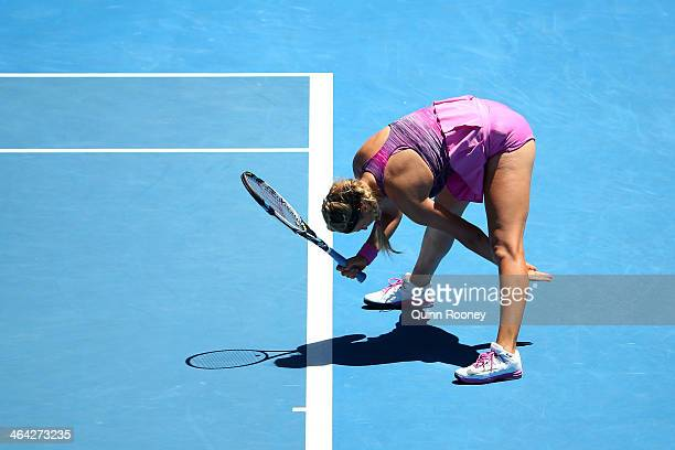 Victoria Azarenka of Belarus reacts to a point in her quarterfinal match against Agnieszka Radwanska of Poland during day 10 of the 2014 Australian...
