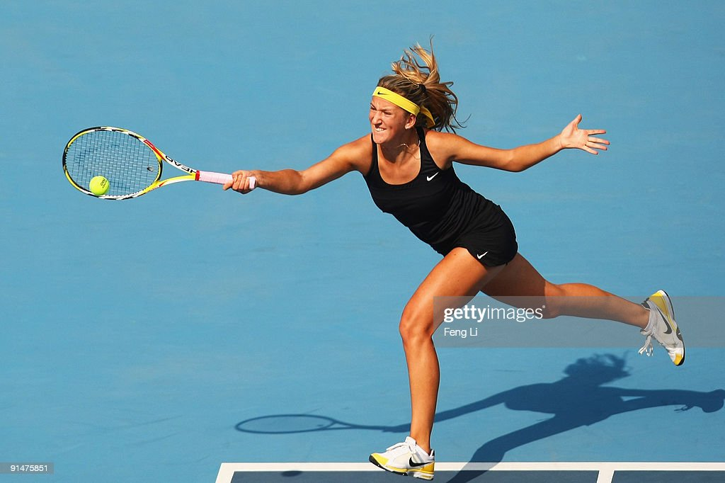 Victoria Azarenka of Belarus returns a shot against Maria Sharapova of Russia in her first round match during day five of the 2009 China Open at the National Tennis Centre on October 6, 2009 in Beijing, China.