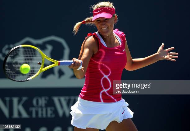 Victoria Azarenka of Belarus returns a shot against Samantha Stosur of Australia during the semifinals of the Bank of the West Classic at Stanford...
