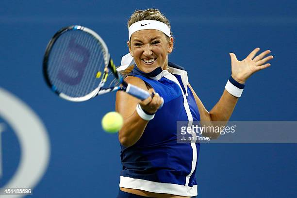 Victoria Azarenka of Belarus returns a shot to Aleksandra Krunic of Serbia during their women's singles fourth round match on Day Eight of the 2014...