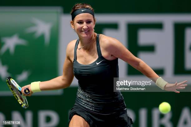 Victoria Azarenka of Belarus returns a shot to Angelique Kerber of Germany in round robin play during the TEB BNP Paribas WTA Championships at the...