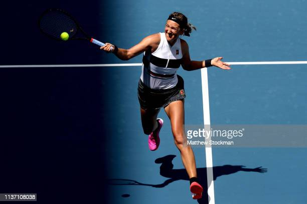 Victoria Azarenka of Belarus returns a shot to Dominika Cibulkova of Slovakia during the Miami Open Presented by Itau at Hard Rock Stadium March 20...