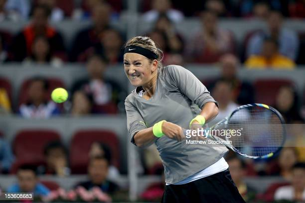 Victoria Azarenka of Belarus returns a shot to Maria Sharapova of Russia during the final of the China Open at the China National Tennis Center on...