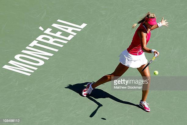 Victoria Azarenka of Belarus returns a shot to Na Li of China during the Rogers Cup at Stade Uniprix on August 19 2010 in Montreal Canada
