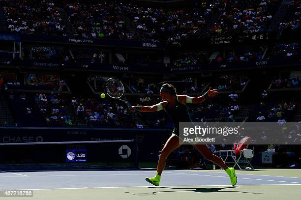 Victoria Azarenka of Belarus returns a shot to Varvara Lepchenko of the United States in their Women's Singles Fourth Round match on Day Eight of the...