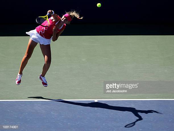 Victoria Azarenka of Belarus serves against Marion Bartoli of France during the quarterfinals of the Bank of the West Classic at Stanford University...