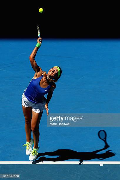 Victoria Azarenka of Belarus serves in her first round match against Heather Watson of Great Britain during day one of the 2012 Australian Open at...
