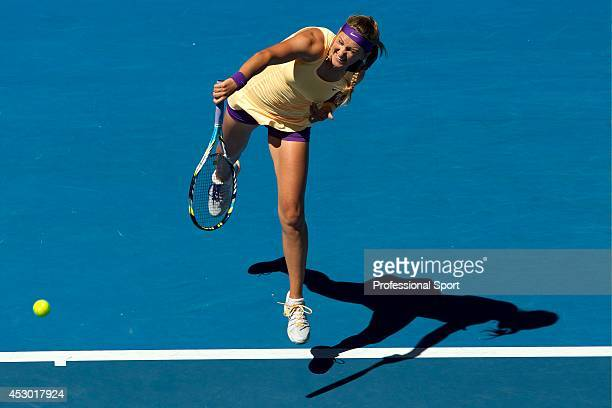 Victoria Azarenka of Belarus serves in her Quarterfinal match against Svetlana Kuznetsova of Russia during day ten of the 2013 Australian Open at...