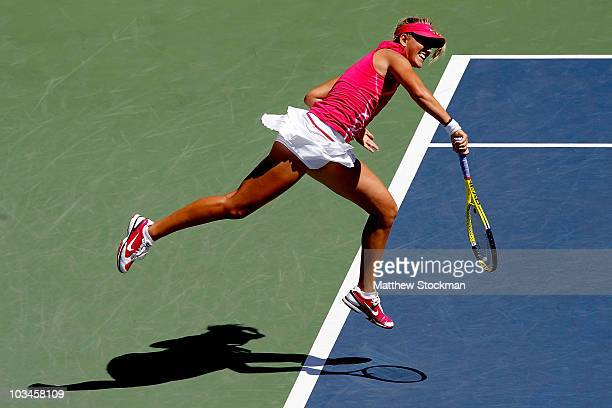 Victoria Azarenka of Belarus serves to Na Li of China during the Rogers Cup at Stade Uniprix on August 19 2010 in Montreal Canada