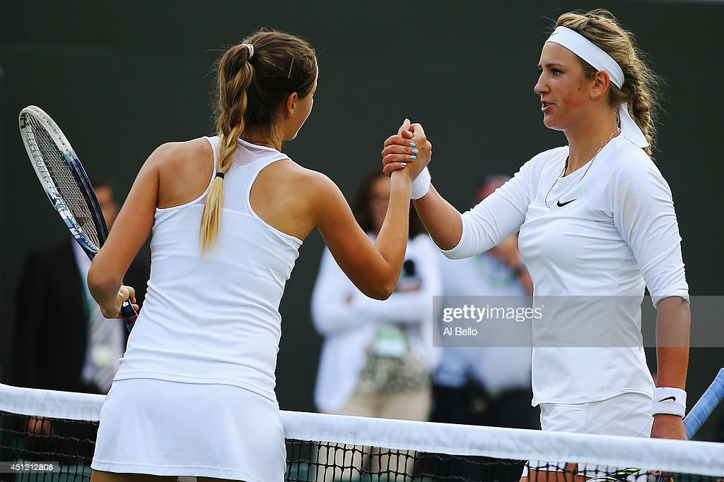 Victoria Azarenka of Belarus (r) shakes hands with Bojana Jovanovski of Serbia after their Ladies' Singles second round match on day three of the Wimbledon Lawn Tennis Championships at the All England Lawn Tennis and Croquet Club at Wimbledon on June 25, 2014 in London, England.