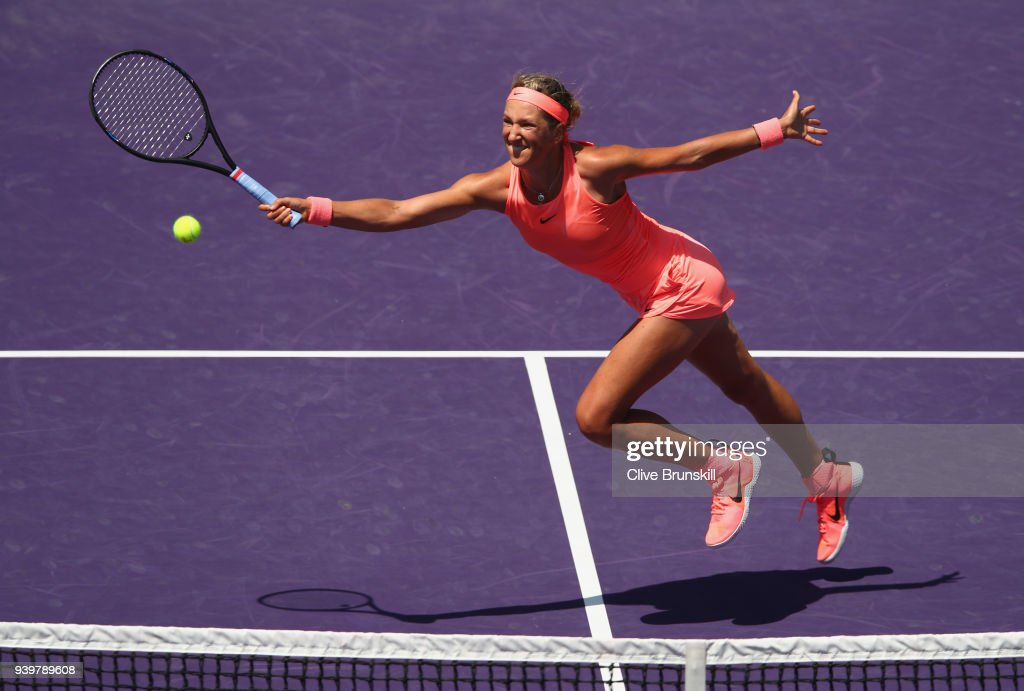 Victoria Azarenka of Belarus stetches to play a forehand volley against Sloane Stephens of the United States in their semifinal match during the Miami Open Presented by Itau at Crandon Park Tennis Center on March 29, 2018 in Key Biscayne, Florida.