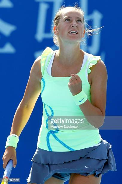 Victoria Azarenka of Russia celebrates a point against Timea Bacsinszky of Switzerland during day five of the 2010 China Open at the National Tennis...