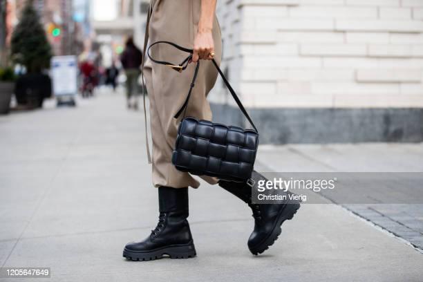 Victoria Barbara is seen wearing Bottega Veneta jumpsuit, Petar Petrov black turtleneck, combat boots Miu Miu, black Bottega Veneta bag, gold rings...