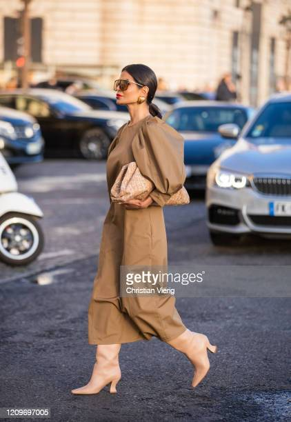 Victoria Barbara is seen wearing camel Givenchy dress, Bottega Veneta cork pouch bag Bottega boots, Givenchy sunglasses, Balenciaga earrings during...