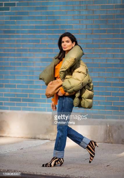 Victoria Barbara is seen wearing Marcus Almeida coat rust brown Bottega Veneta sweater Khaite denim jeans and boots with animal print Bottega Veneta...