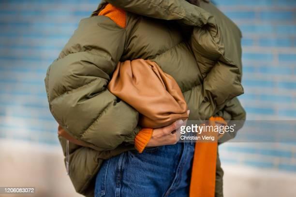 Victoria Barbara is seen wearing Marcus Almeida coat rust brown Bottega Veneta sweater Khaite denim jeans Bottega Veneta camel pouch during New York...