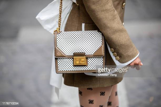 Victoria Barbara is seen wearing olive white two tone blazer, tights with print, bag all Fendi during Milan Fashion Week Spring/Summer 2020 on...