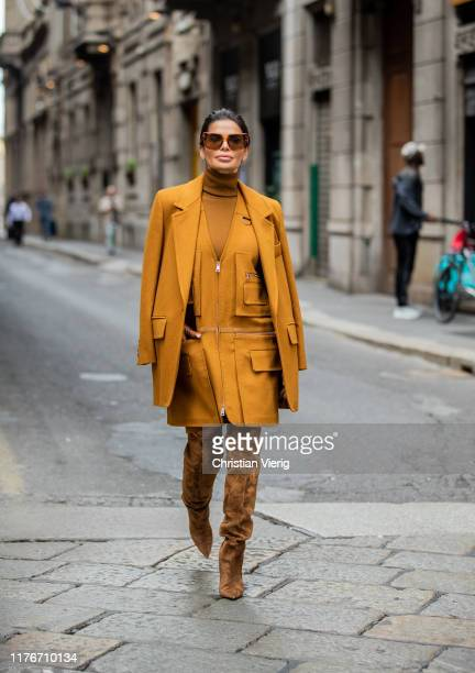 Victoria Barbara is seen wearing orange brown Max Mara jacket, zipped dress with pockets, turtleneck and brown gloves, wild leather boots Saint...