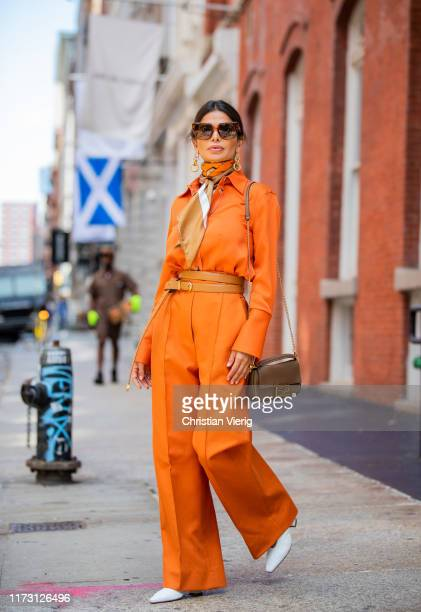 Victoria Barbara is seen wearing orange pants and button shirt scarf Khaite Bottega Veneta shoes and jewelry Fendi bag during New York Fashion Week...
