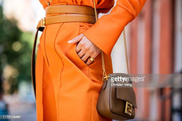 Victoria Barbara is seen wearing orange pants Khaite Bottega Veneta jewelry Fendi bag during New York Fashion Week September 2019 on September 07...