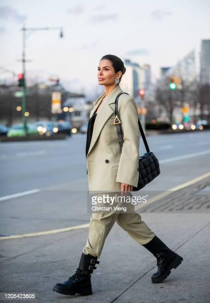 Victoria Barbara is seen wearing Proenza Schouler suit, black top, Miu Miu combat boots, black Bottega Veneta padded cassette bag, Balenciaga...