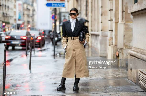 Victoria Barbara is seen wearing two tone black beige Alexander McQueen trench coat, combat boots Miu Miu, Givenchy sunglasses, white button down...