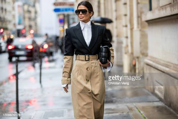 Victoria Barbara is seen wearing two tone black beige Alexander McQueen trench coat, Givenchy sunglasses, white button down high neck shirt Fendi,...