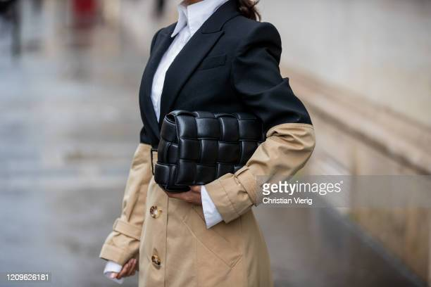 Victoria Barbara is seen wearing two tone black beige Alexander McQueen trench coat, white button down high neck shirt Fendi, black Bottega Venetta...