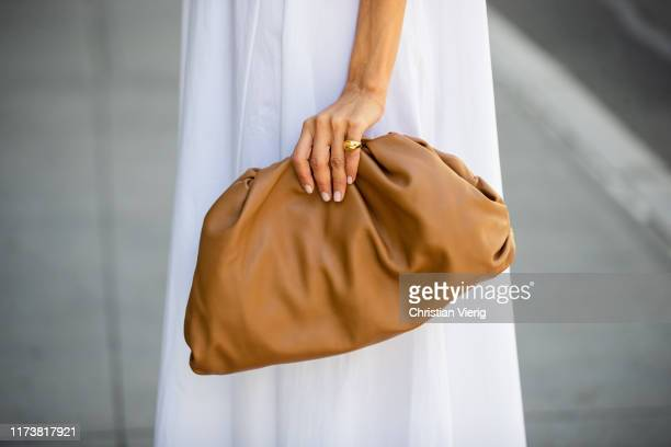 Victoria Barbara is seen wearing white dress The Row clutch Bottega Veneta during New York Fashion Week September 2019 on September 09 2019 in New...